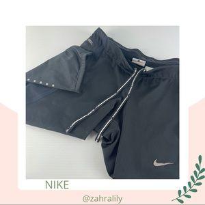 NIKE Running Size XS Zip Pocket Reflector Logo Elastic Leg Fitted Shorts